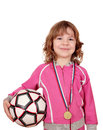 Little girl with gold medal and soccer ball on white Royalty Free Stock Images