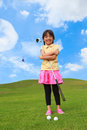 Little girl at golf club Stock Image