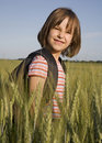Little girl in grain field Stock Photography