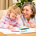 Little girl with grandmother drawing together Royalty Free Stock Photography