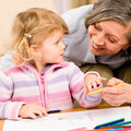 Little girl with grandmother drawing together Royalty Free Stock Photos