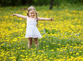Little girl  on grass in flower. Royalty Free Stock Photo