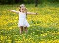 Little girl  on grass in flower. Royalty Free Stock Photo