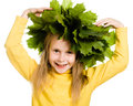 Little girl with green maple leaves on the head Stock Photo