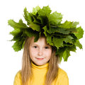 Little girl with green maple leaves on the head Royalty Free Stock Images