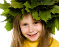 Little girl with green maple leaves on the head Royalty Free Stock Image