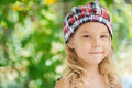 Little girl in green summer city park portrait of beautiful smiling Royalty Free Stock Photo
