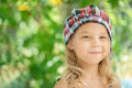 Little girl in green summer city park portrait of beautiful smiling Royalty Free Stock Images