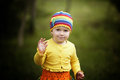 Little girl greets hands up funny outdoors Stock Images