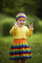 Little girl greets hands up funny outdoors Royalty Free Stock Photos