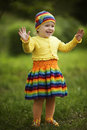 Little girl greets hands up funny outdoors Royalty Free Stock Image