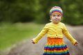 Little girl greets hands up funny outdoors Stock Image