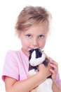 Little girl with guinea pig cute in his hands isolated on white Stock Photo