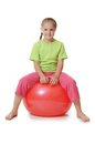 Little girl on a gymnastic ball the Royalty Free Stock Photography