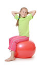 Little girl on a gymnastic ball the Stock Image