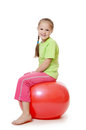 Little girl on a gymnastic ball the white Royalty Free Stock Image