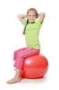 Little girl on a gymnastic ball the white Royalty Free Stock Images