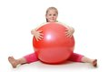 Little girl with a gymnastic ball the on on white Royalty Free Stock Photography