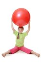 Little girl with a gymnastic ball the on on white Stock Image