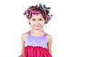 Little girl with  hair-curlers Stock Images