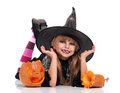 Little girl in halloween costume portrait of black hat with pumpkin isolated on white background Stock Photo