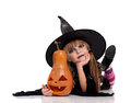 Little girl in halloween costume portrait of black hat with pumpkin isolated on white background Royalty Free Stock Photos