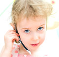 Little girl hands free device child helpline concept Stock Images