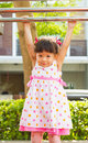 Little girl hanging on a bar healthy Royalty Free Stock Image