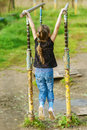 Little girl hanging on old exercise Royalty Free Stock Images