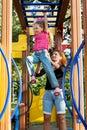 Little girl hangs by horizontal bar Royalty Free Stock Photos