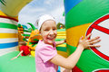 Little girl has fun at inflatable attractions joyful in park Royalty Free Stock Photo
