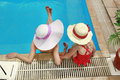 Little girl in a hat with mother in swimming pool Stock Image