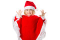 Little girl in a hat Santa Claus on white background. Royalty Free Stock Photo