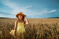 Little girl in hat on wheat field Royalty Free Stock Photo
