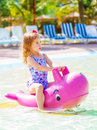 Little girl have fun in aquapark cute floating having poolside daycare summer holidays water attractions happy childhood concept Royalty Free Stock Images
