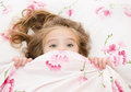 Little girl having childhood nightmares and fears hiding under the quilt Royalty Free Stock Images