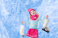 Little girl having fun at ice skating in winter Royalty Free Stock Photo