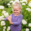 Little girl having fun playing in garden Stock Image