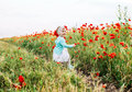 Little girl having fun in poppy field Royalty Free Stock Photo