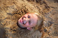 Little girl having fun in sand box Stock Image