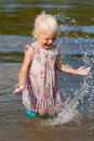 Little girl having fun in water Stock Photo