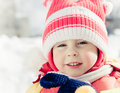 Little girl having fun on winter day Stock Photos