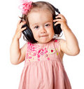 Little girl with headphones Stock Photography
