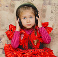 Little girl with headphones Stock Image