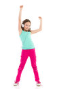 Little girl with headphones dancing with arms raised