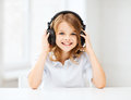 Little girl with headphones at home technology and music concept Royalty Free Stock Photos