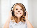 Little girl with headphones at home technology and music concept Royalty Free Stock Photo