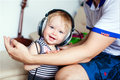 The little girl in headphones, smiling