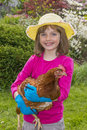 Little girl with a hen happy Stock Photo