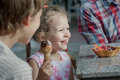 Little girl and her brother laughing during eating Italian ice cream Royalty Free Stock Photo